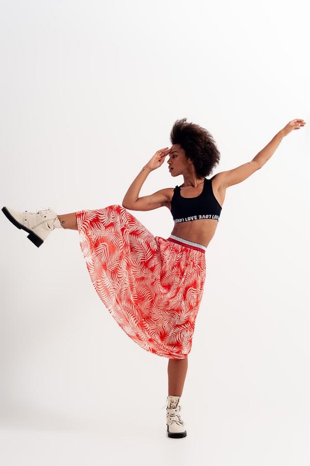 Falda larga plisada con estampado floral rojo