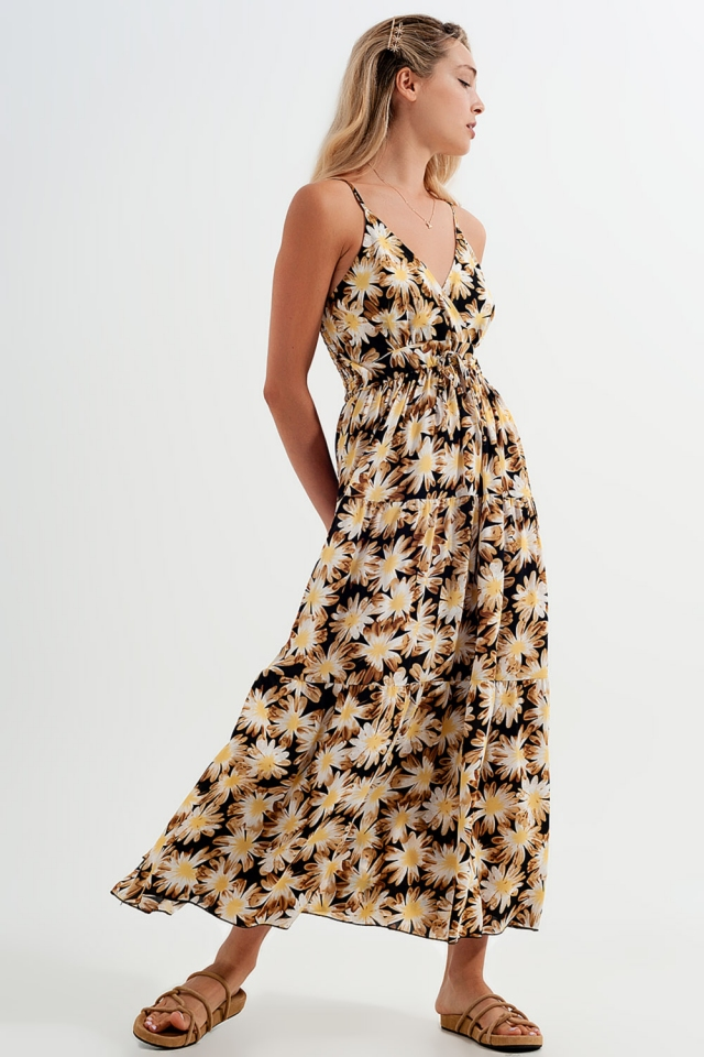 Vestido largo amarillo de tirantes con estampado floral y diseño cruzado