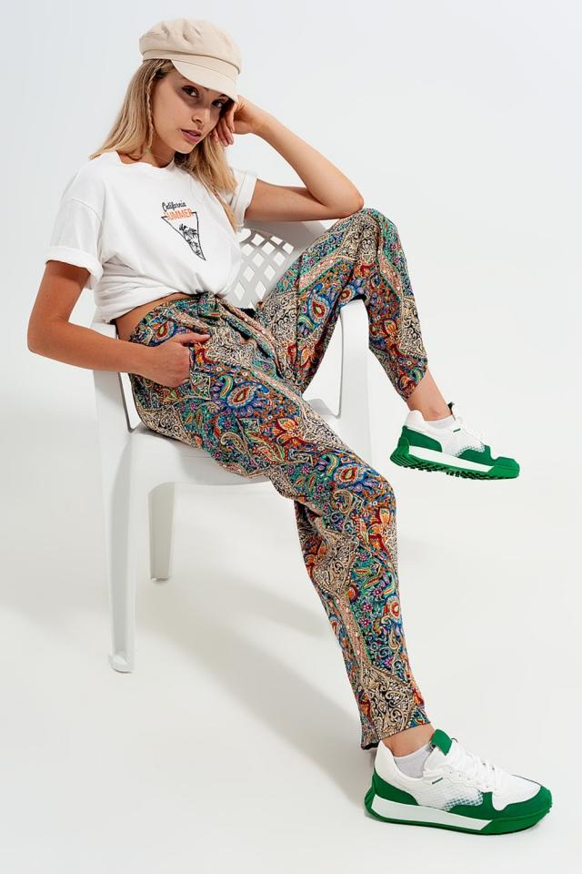 Pantalones verdes de pernera ancha con diseño de hojas de jacquard de satén