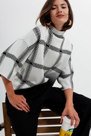 Jersey crema con diseño de cuadros monocromáticos