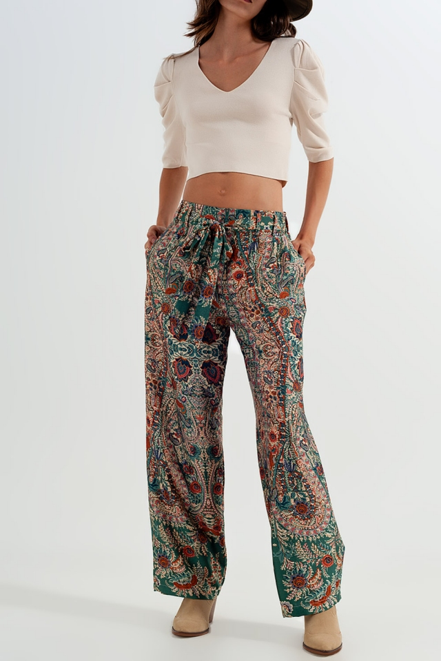 Pantalones de pernera ancha con estampado de cachemir y acabado sedoso en verde